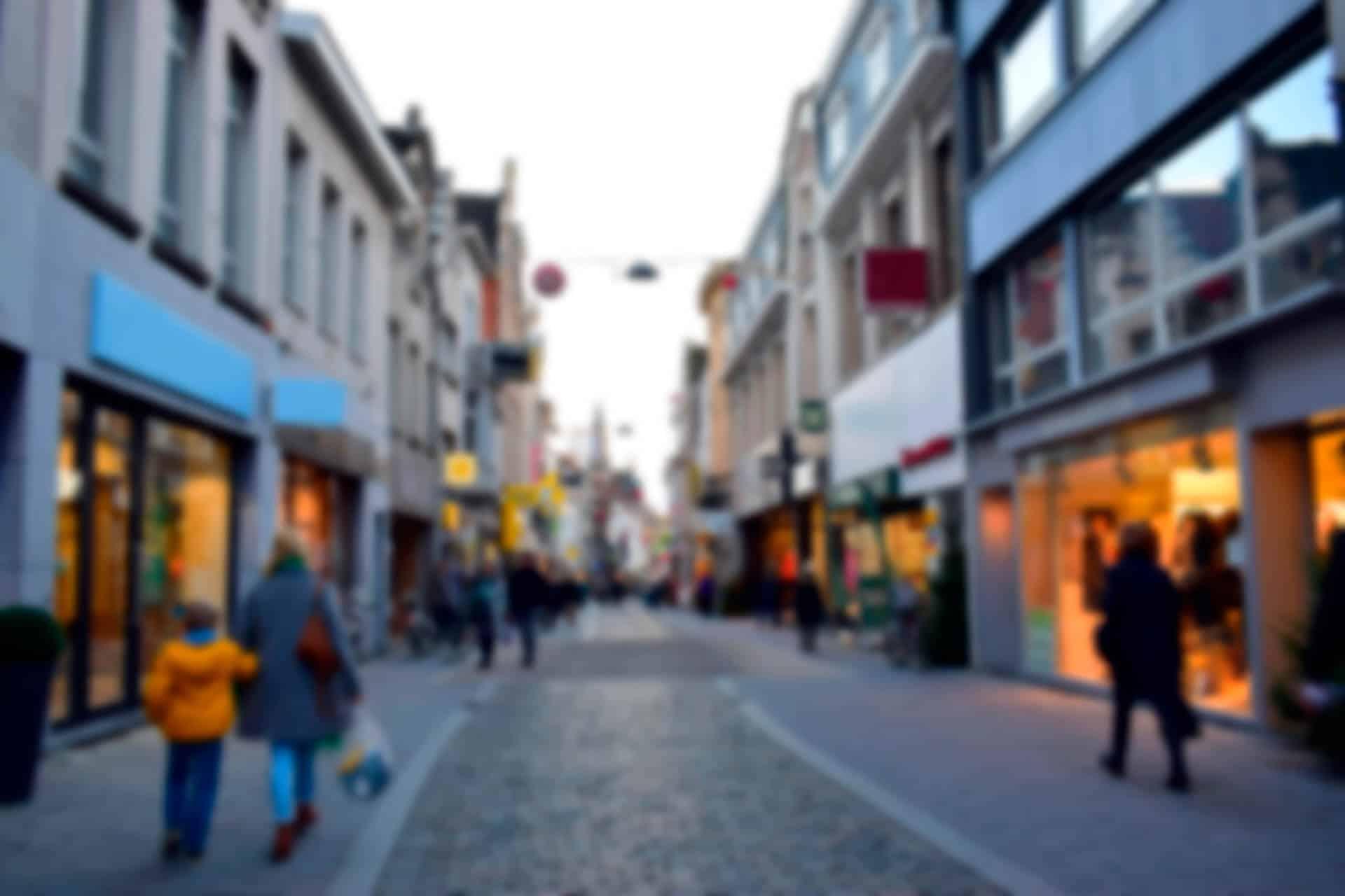Blurred Pedestrians Walk In A Shopping District
