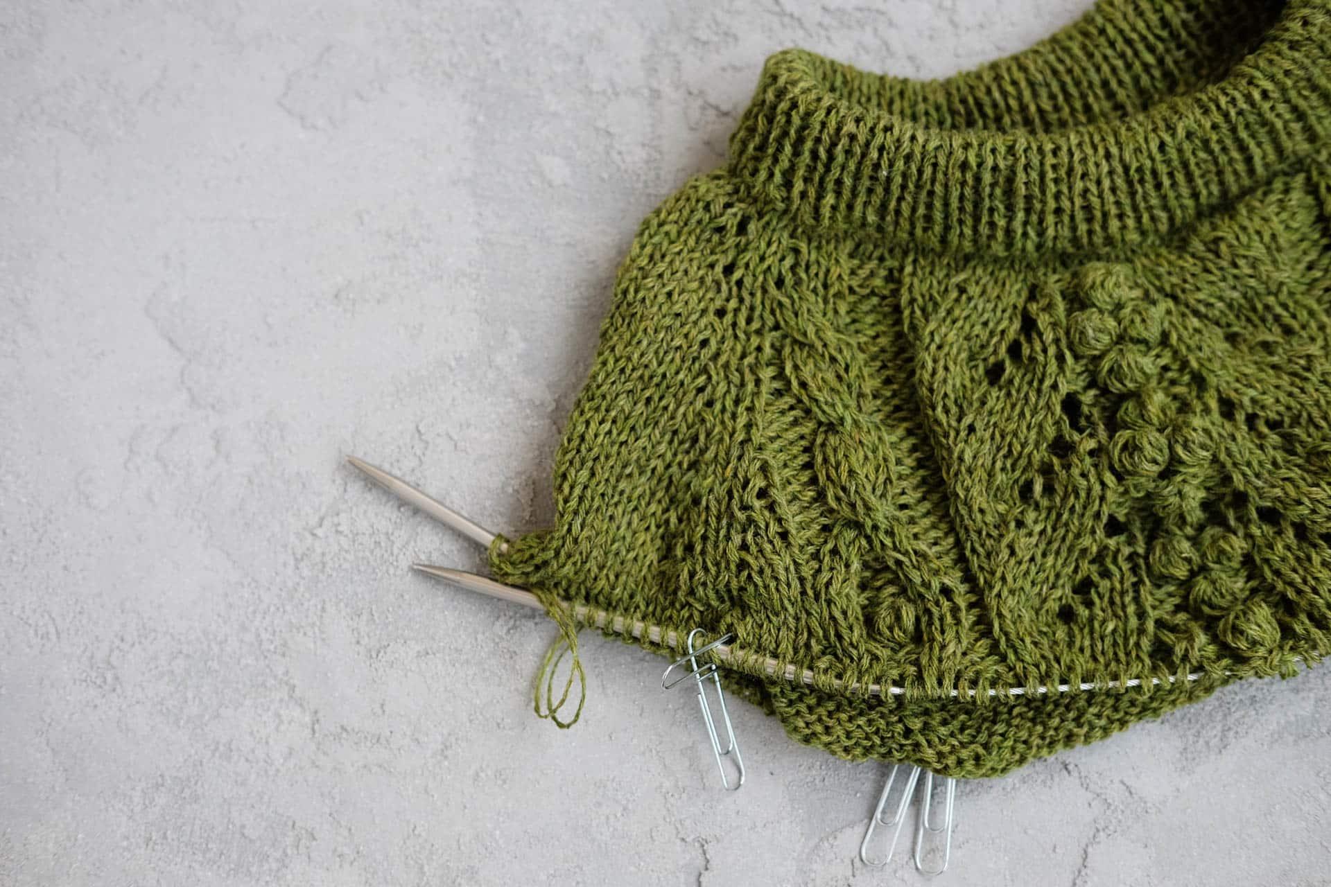 Green wool knitted jumper. Work in progress.