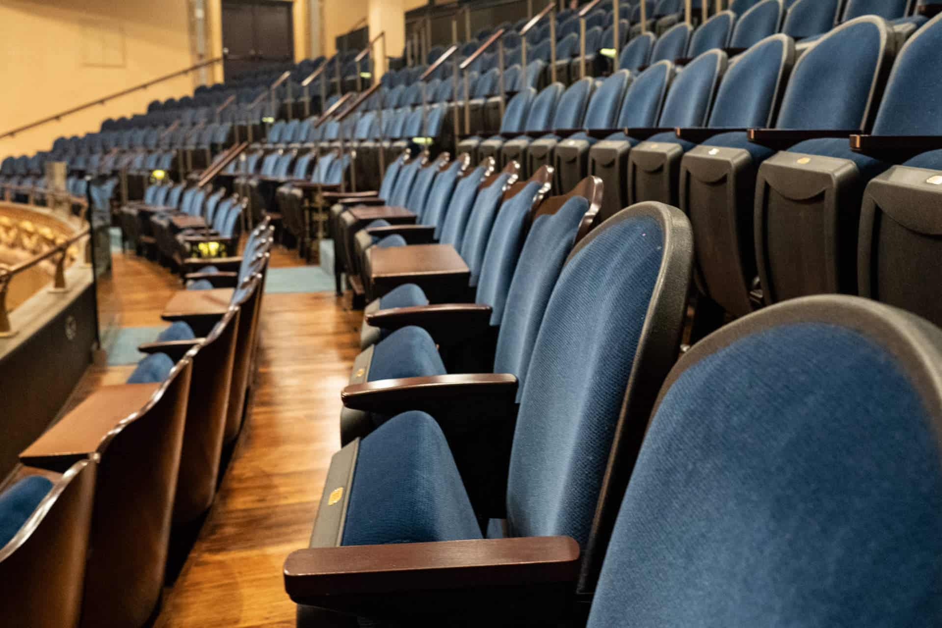 Empty row of chairs in a lecture hall