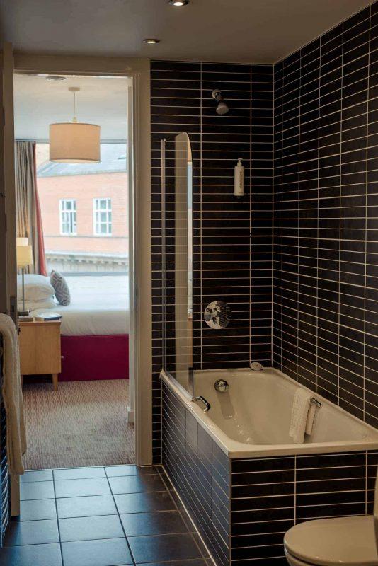 Bathroom at PREMIER SUITES Liverpool with modern tiling
