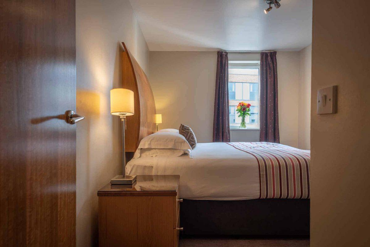 Bedroom in apartment at PREMIER SUITES Birmingham