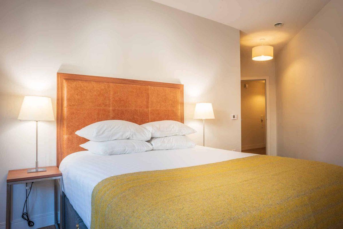 Bright comfortable bedroom at PREMIER SUITES PLUS Glasgow Bath Street