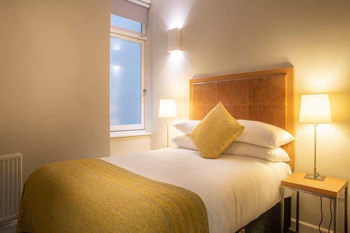 Bright, spacious bedroom at PREMIER SUITES PLUS Glasgow George Square