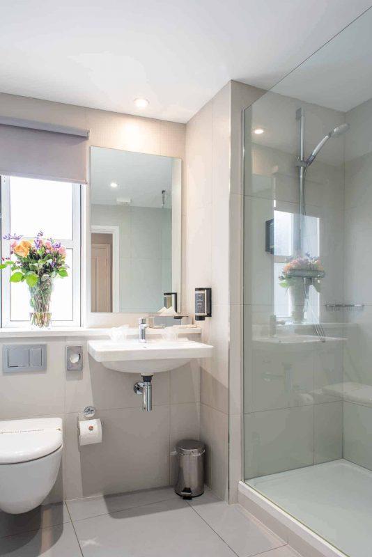 Modern bathroom with shower at PREMIER SUITES Reading