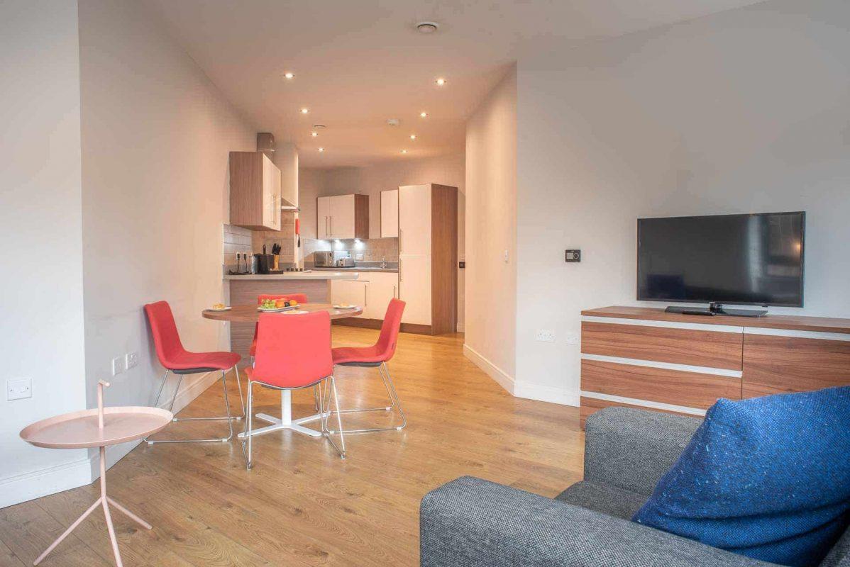 Open plan lounge and kitchen at PREMIER SUITES PLUS Glasgow Bath Street