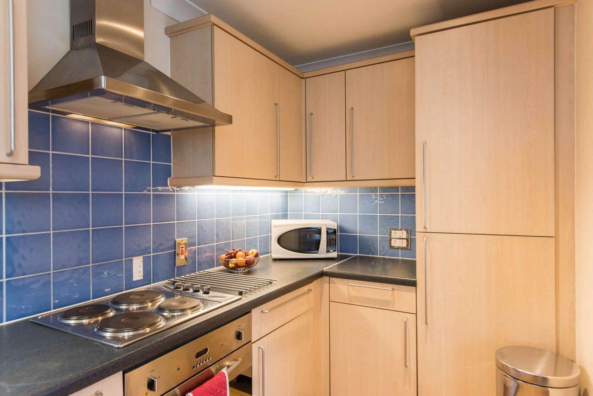 PREMIER SUITES Bristol Redcliffe kitchen with fridge
