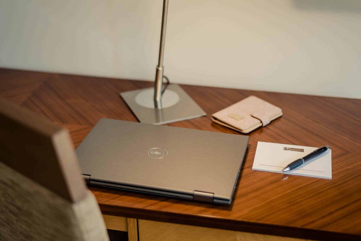 PREMIER SUITES Dublin Sandyford (desk closeup of laptop)