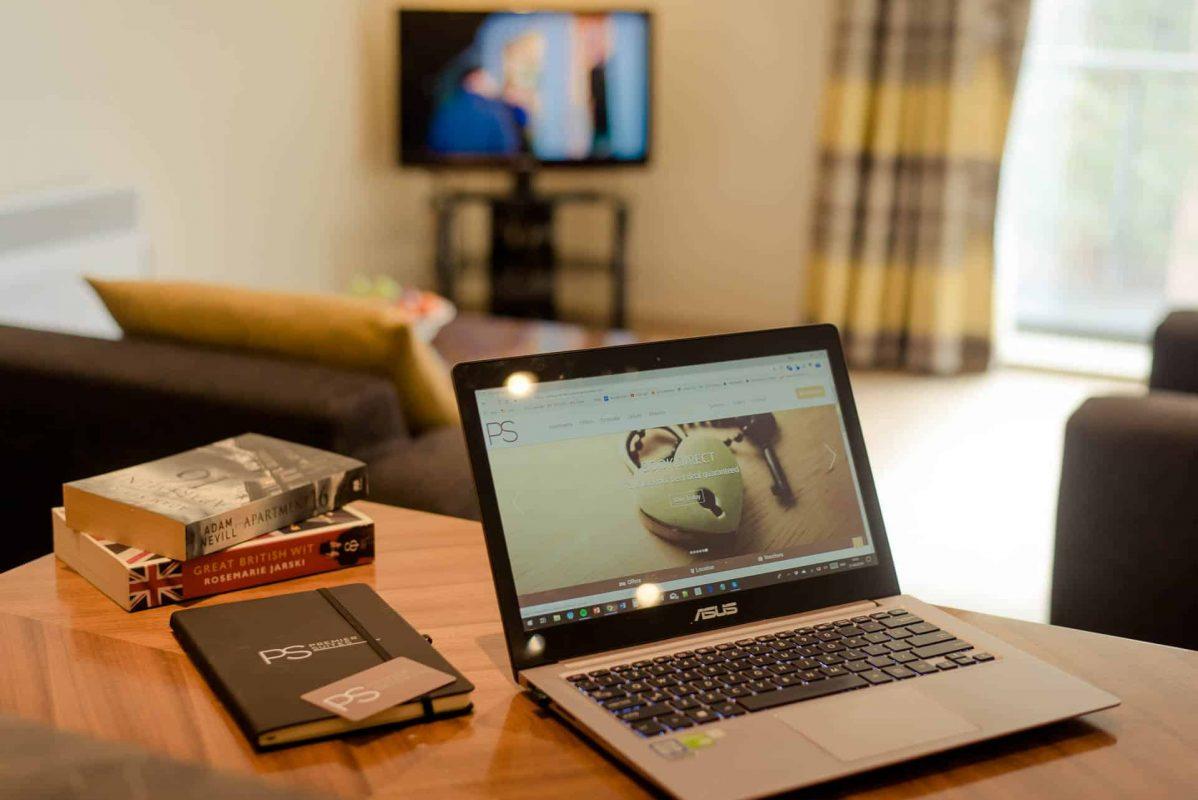 PREMIER SUITES Manchester one bedroom apartment laptop