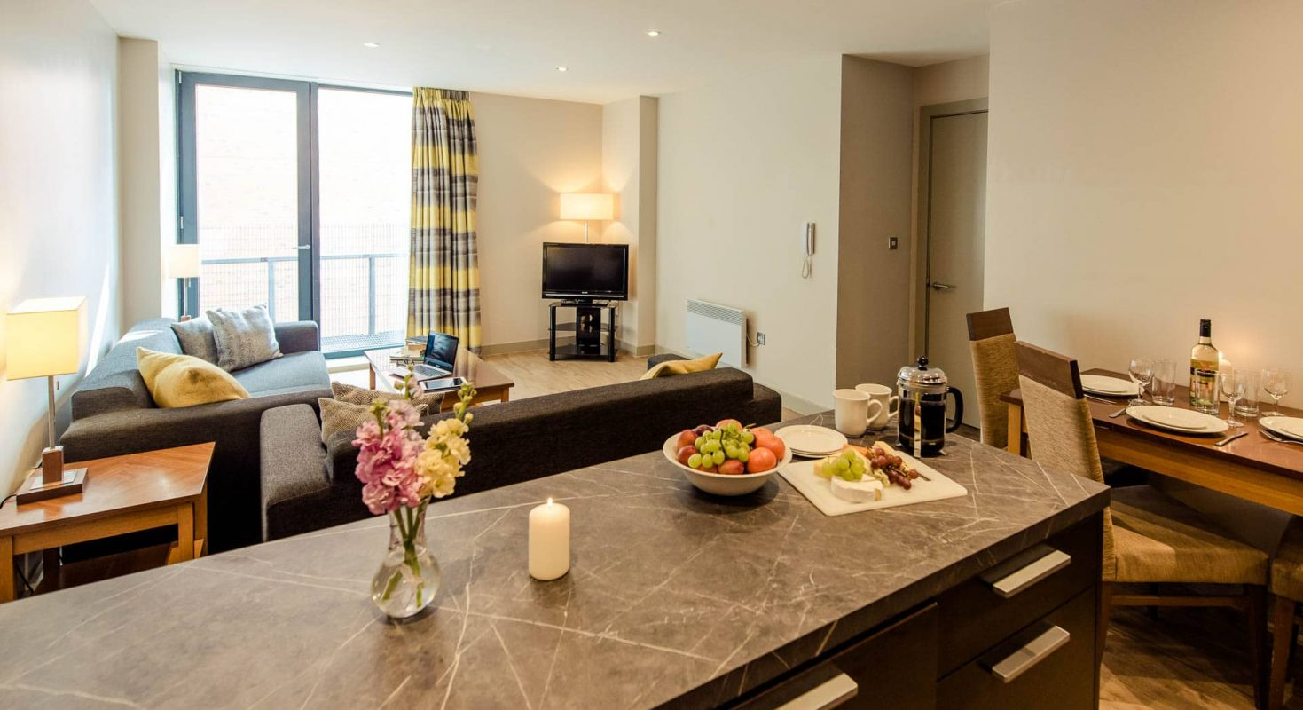 PREMIER SUITES Manchester two bedroom kitchen island and living area